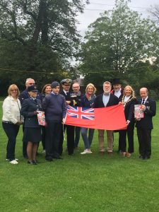 Photo of council and guests with Red Ensign