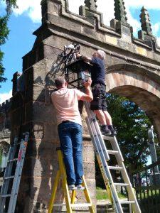 Photo: lychgate lamp being restored